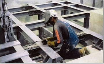 Worker Doing Repairs on Framing